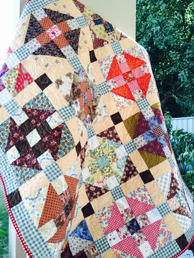 """Monkey Wrench Charm Square Quilt"" a Free Scrappy Quilt Pattern designed by Susie from Susie's Scraps"