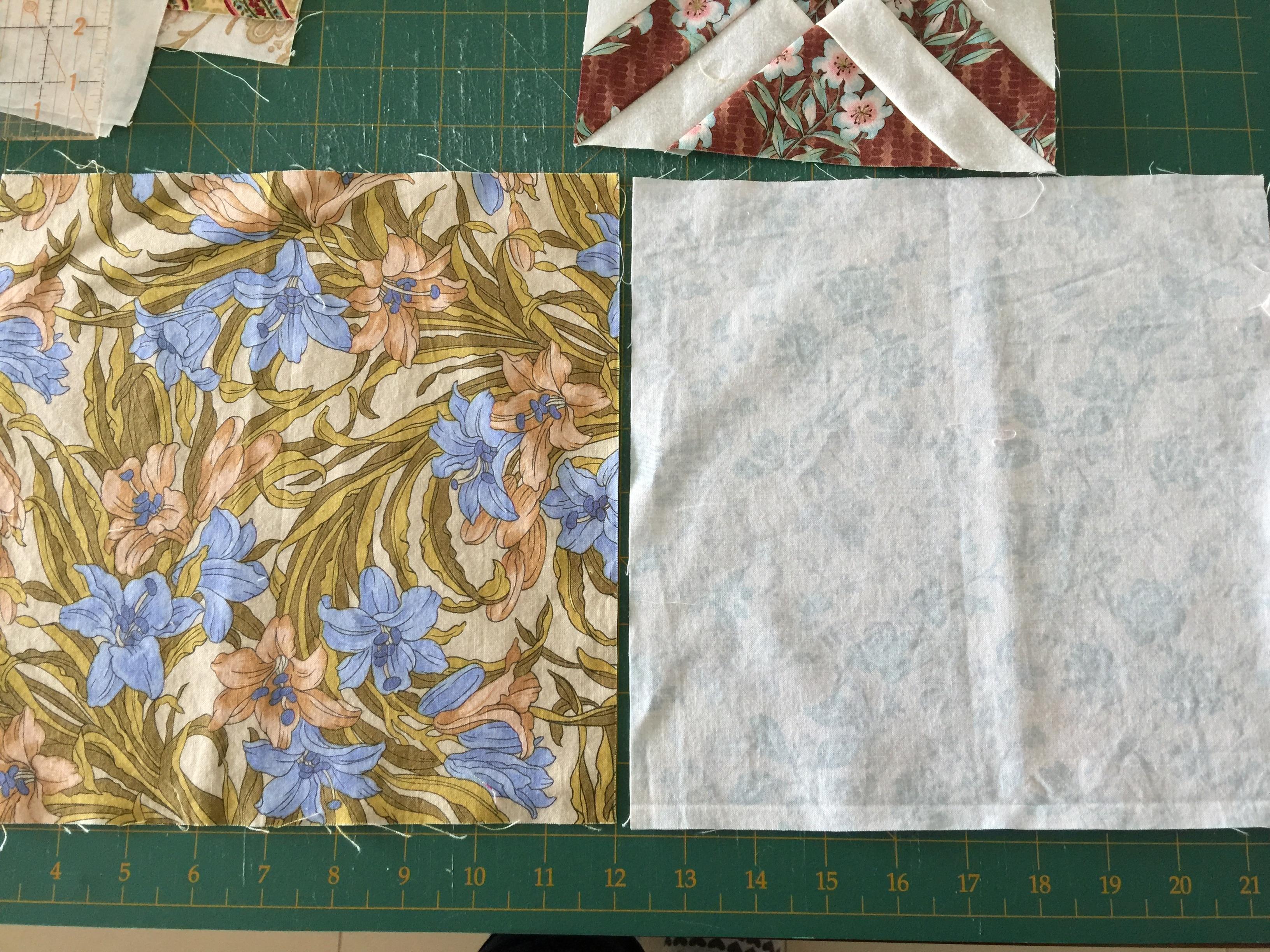 White with orange 16 stitched Vintage Cross-stitch quilt Squares 12 un-stitched green.