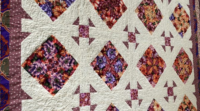 Purple posies on point quilt